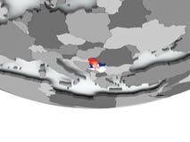 有旗子的塞尔维亚在地球 库存照片
