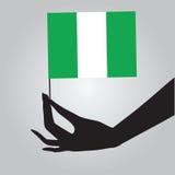 有旗子的尼日利亚手 库存例证