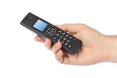 有无线无线电话的手 库存照片