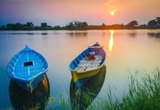 有日落的两条小船 免版税库存照片