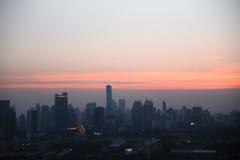 有日落的城市在曼谷在泰国 免版税图库摄影