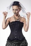 有时尚哥特式样式的妇女 免版税库存照片