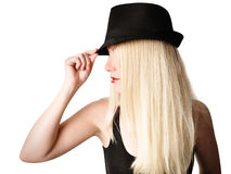 有时尚帽子和头发的俏丽的女孩在白色 库存照片
