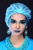 有时尚的美丽的亚裔耐心妇女组成,蓝色口气ac 库存图片