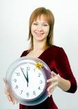 有时钟的可爱的女孩 库存图片