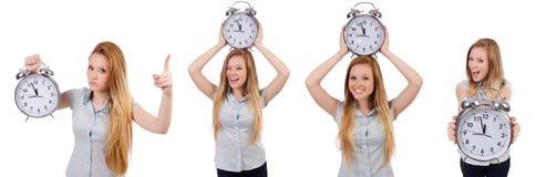 有时钟的少妇在白色 免版税库存图片
