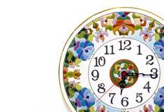有明亮的样式的陶瓷时钟在白色背景 库存照片
