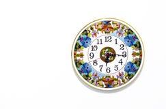 有明亮的样式的陶瓷时钟在白色背景 免版税库存图片