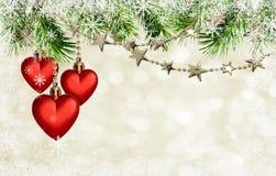 有星的圣诞节诗歌选和在holid的红色心脏装饰 免版税库存图片