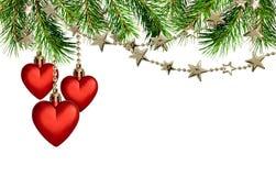 有星的圣诞节诗歌选和红色心脏装饰和杉木 免版税库存图片