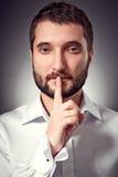 有显示静音符号的胡子的人 免版税库存图片