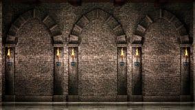 有曲拱和火炬的石墙 免版税库存图片