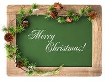 有木制框架和圣诞节装饰的黑板 免版税库存图片
