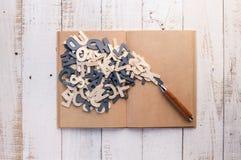 有木字母表的木铅笔 免版税库存照片