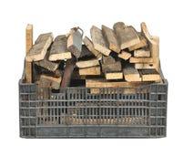 有木柴的塑料盒 库存照片