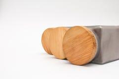 有木盖子的三个瓶子 图库摄影