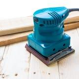 有机器铺沙的木匠 库存照片