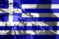 有机枪的战士有希腊的国旗的 图库摄影