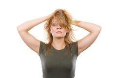 有杂乱头发的疯狂,疯狂的白肤金发的妇女 免版税库存照片