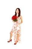 有束的女孩玫瑰。 免版税库存图片
