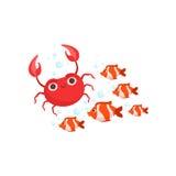 有条纹的红色热带鱼学校和红色螃蟹套海生动物 免版税库存照片