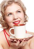 有杯子的白肤金发的妇女 库存照片