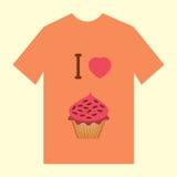有杯形蛋糕的图象的橙色T恤杉 库存照片