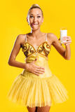 有杯的芭蕾舞女演员牛奶或酸奶 库存图片