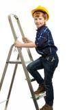 有板钳工具的小男孩 免版税库存照片