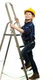 有板钳工具的小男孩 免版税图库摄影