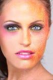 有极端的妇女被洒在面孔组成 免版税库存照片