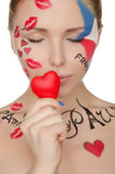 有构成的美丽的妇女在法国的题目 库存照片