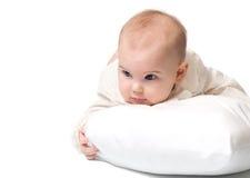有枕头的婴孩 库存照片