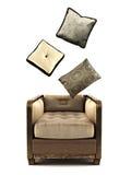 有枕头的扶手椅子在白色 免版税库存照片