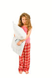有枕头的脾气坏的小女孩 免版税图库摄影
