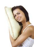 有枕头的年轻俏丽的妇女 免版税库存照片