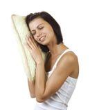 有枕头的年轻俏丽的妇女 免版税图库摄影