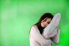 有枕头被隔绝的色度钥匙的女孩 免版税库存照片