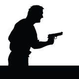 有枪剪影的人 免版税库存图片