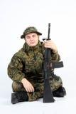 有枪的一位战士 免版税库存照片