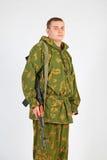 有枪的一位战士 免版税库存图片