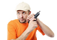 有枪的有胡子的人 免版税库存图片