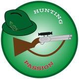 有枪的狩猎帽子在绿色圆环 图库摄影