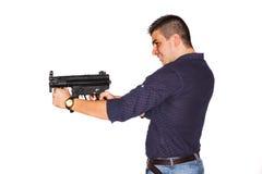 有枪的年轻人 免版税库存照片