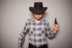 有枪的年轻牛仔 库存照片