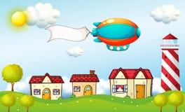 有标志的一个航空器在村庄上 库存图片