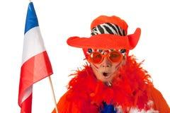 有标志的荷兰语妇女和帽子作为足球迷 库存照片