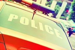有标志警察的橙色警车 免版税库存图片