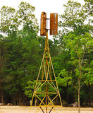 有树的老风车在内地泰国 图库摄影