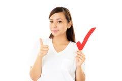 有校验标志的妇女 免版税库存图片